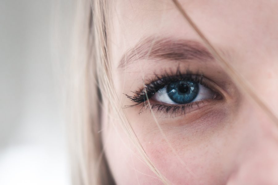 Blue eyed woman receiving EMDR therapy
