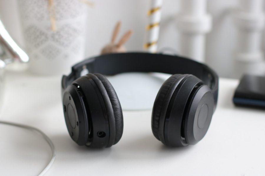 Unplugged headphones laying on desk.
