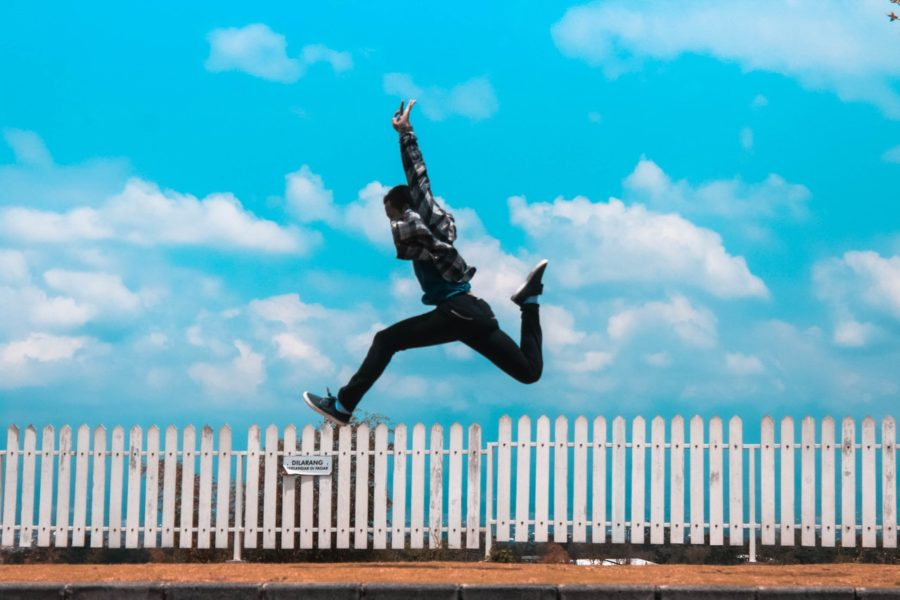 Young man jumping into air in excitment.